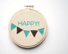 "I love how they mixed xstich with bunting...But I would do someone's name or something else besides ""Happy!"""
