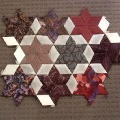 The handmade upcycled silk quilt is still in progress.