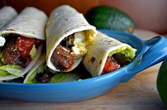 """""""Steak Tacos with Guacamole, Salsa, and Lime Crema."""