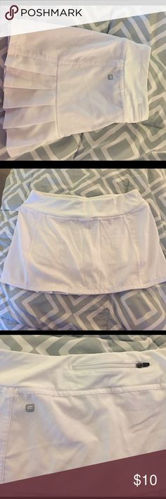 Fabletics by Kate Hudson athletic skort. NWOT fabletics athletic skort. White. Never worn. Pocket with zipper on back. Fabletics Shorts Skorts