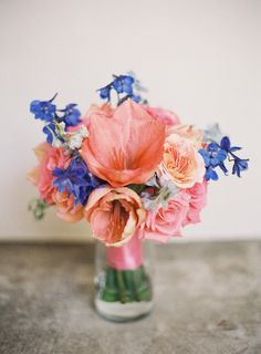 Bright bluebells play against bold coral tulips in this vivacious bouquet (photography by http://mwfoto.com)