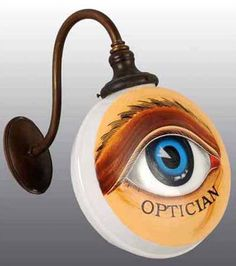 Image from http://theopticalvisionsite.com/wp-content/uploads/2012/07/Optician-Trade-Sign-Milk-Glass-Globe-sold-by-Dan-Morphy-Auctions.jpg.