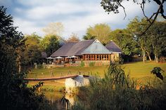 Hippo Hollow Country Estate offers elegant rooms on the edge of the Sabie River in Hazyview, 20 minutes' drive from the Kruger National Park. Reptile Park, Holiday Hotel, Hotel Reservations, Country Estate, Outdoor Pool, South Africa, Places To Visit, Cabin, House Styles