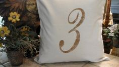 French Farmhouse Distressed Number Pillow by TheElegantClutter