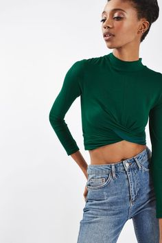 Take the crop top to the next season in this cool long sleeve version with twist front detail and a flattering high neck. Team with high waisted jeans and ankle boots for a no-fuss outfit. #Topshop
