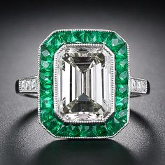 3.0 ct. diamond and emerald ring