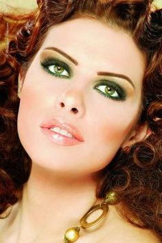 green eyes...this makeup really makes the eyes pop...wish I could do it without ending up looking like a hooker lol
