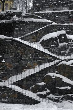 Snow covered staircase with digital graffiti on Södermalm in central Stockholm, Sweden