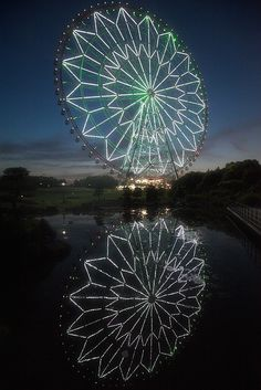 Ferris wheel in the night by cocoip, via Flickr