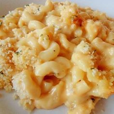 "Home-Style Macaroni and Cheese | ""A Cheddar and cream cheese sauce with a touch of Dijon is mixed with macaroni pasta, topped with bread crumbs, and baked."" (Baking Macaroni And Cheese Families)"
