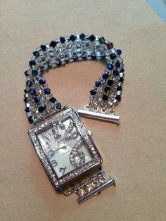 Used Swarovski bicones & seed beads in this design. Lots of bling!i have the 925 Sterling Silver catch and a watch head this is on to do list Beaded Watches, Jewelry Watches, Beaded Jewelry, Handmade Jewelry, Beaded Bracelets, Apple Watch Bands, How To Make Beads, Bracelet Patterns, Jewelry Crafts