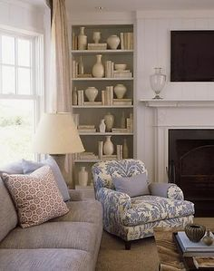 Chair next to fireplace Soft furnishings bookcase