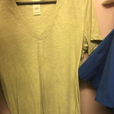 Pink V- neck Yellow Pink v- neck. Not sure why I purchased a large, but fair condition. Been worn a number of times. PINK Victoria's Secret Tops Tees - Short Sleeve