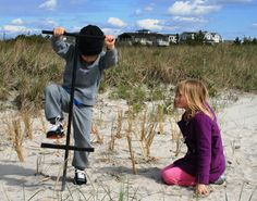 Kids get into the act in Avalon Dune Grass Planting.jpg (500×394)