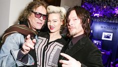 Model Gia Genevieve loving the attention from Walking Dead star Norman Reedus and rock & roll photographer Mick Rock at The Macallan Masters of Photography: ...
