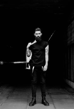 Unbreakable: Photo black on black jeans boots leather shirt tattoo tatted beard hair streetstyle hipster t shirt menswear fashion