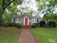 Love the Red door with the gray brick.