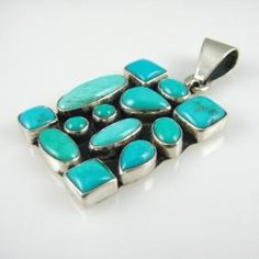 "Turquoise Multi-Cab Pendant  by Dee Nez  More By This Artist  Sterling Silver Rectangular Pendant Set with Multiple Turquoise Stones.  Item #: 79858  Tribe: Navajo  Technique: Set Stones  Metal: Sterling Silver  Height: 1.875""  Width: 1""  Availability:  In stock.  Price:   $230"