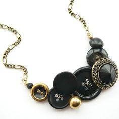 Black Vintage Button Bib Necklace with Antique Gold Brass, via Etsy.