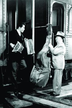 Alfred hitchcock and Farley granger in strangers on a train.
