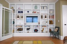 I would like to do something like this in our family room. An entire wall of built-ins, with space for a TV in the center (or artwork, or anything really). NW Quimby Residence - JACK BARNES ARCHITECT