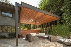 Floating canopy with overarching steel post to open space up without walls #architecture #open #space #patio #yard #design