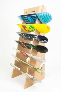 Check it out! This floor storage rack lets you keep all your skateboards, longboards, and snowboards neatly stored and out of the way. No need to hang this one on the wall or use hardware and tools to