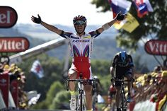 Spain's Joaquim Rodriguez celebrates as he crosses the line at the end of the 159.5 km third stage.