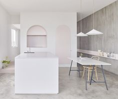 Completed in 2016 in Melbourne, Australia. Images by Haydn Cattach. This apartment in Melbourne Australia was renovated to maximise access of natural light whilst opening up the circulation between spaces to create...that stove, hood and refrigerator!