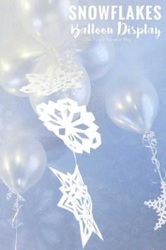 Snowflakes Balloon Display - lots of fun to make for a ceiling full of snowflakes on Christmas morning or for a winter or Frozen themed party!