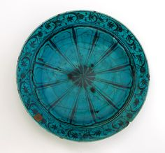 Dish  17th century  Stone-paste with black decoration under turquoise/blue glaze  H: 6.1 W: 35.1 D: 35.1 cm   Iran