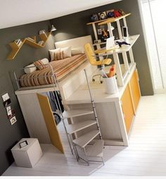 The most functionality in the smallest space ... this multi-use room with pedestal bed over closet space and raised desk workspace over ... concealed drawer storage and accessed by a curved ladder. finally a room that doesn't waste the airspace!