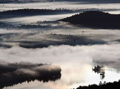 Morning Fog, Adirondacks. Morning fog shrouds the surface of Bear Pond and the valleys below St. Regis Mountain.