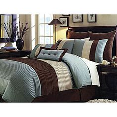 @Overstock - Enjoy a relaxing night's sleep with a this new comforter set. This lovely bedding set features a contemporary horizontal band design in blue, beige and brown with pintuck detailing.http://www.overstock.com/Bedding-Bath/Handcrafted-Blue-Pintuck-Faux-Silk-8-piece-Comforter-Set/6310710/product.html?CID=214117 $69.99
