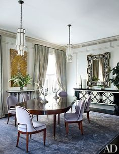 1940s Baguès pendant lights, a French Art Deco wall plaque, and a '40s-style Venetian mirror, all from Newel. Ralph Lauren Home candelabra top the circa-1800 French table from Bernd Goeckler Antiques; the chairs, custom made in the manner of Émile-Jacques Ruhlmann, are upholstered in a Lee Jofa mohair, and the midcentury Italian cabinet is faced with Murano glass.