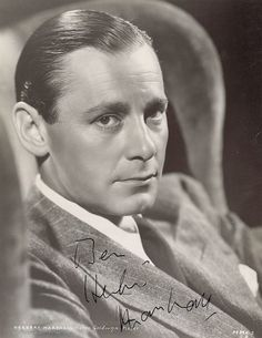 """Herbert Marshall, 1933, The term """"Hollywood Raj"""" was given to a group of British actors who quietly invaded Hollywood during the late 1920s and the 1930s. Combing melancholy and wistfulness wrapped in a suave British accent, it was personified by such stalwart greats as Leslie Howard, Cary Grant, Basil Rathbone, C. Aubrey Smith, Ronald Colman, Claude Rains, David Niven, Donald Crisp, Herbert Marshall, Brian Aherne and Victor McLaglen."""