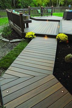 TimberTech decking walkway from our Earthwood Evolutions Legacy collection in Tigerwood with Mocha accents. Complete with in-deck lights and riser lights for nighttime!