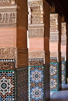 Stucco engraving and zellige tiles inside a Moroccan madrassa