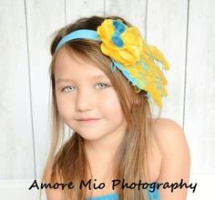 Headband Yellow and Peacock blue curly Feathers with a peacock blue veil netting with a satin and tulle yellow rosette Headband Sale! $6.49