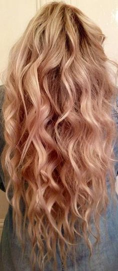 Pretty blonde waves done with a flat iron.