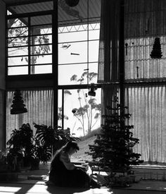 Ray Eames in the Eames House living room, Christmas 1949. The couple moved in on Christmas Eve with very little and furnished the home sl...