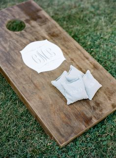 Elegant & Cornhole aren't usually found in the same sentence ;) But this cornhole board really kind of embodies rustic elegance! See more of the wedding here: http://www.StyleMePretty.com/2014/04/14/elegant-tennessee-plantation-wedding/ Photography: AustinGros.com on #smp