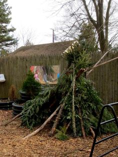 Teepee made from Christmas tree branches (via Takoma Park Cooperative Nursery School) Christmas Tree Forest, Christmas Tree Branches, Outdoor Learning, Outdoor Play, Outdoor Ideas, Learning Spaces, Learning Environments, Communication Friendly Spaces, Sunflower House