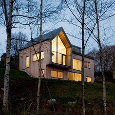 Kjellgren Kaminsky completes church-inspired villa beside a lake in Sweden
