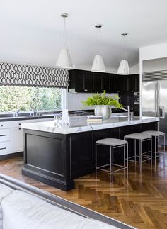 The refurbished kitchen of this Colonial-style Queenslander, with Carrara marble and stainless steel benchtops, has plenty of storage and prep space. Photography: Maree Homer   Stylist: Kate Nixon