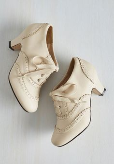 Is today one of those days when you just can't resist strutting the whole way from breakfast to bedtime? Perfect! These ModCloth-exclusive mid heels have the tendency to groove, too, so lace up their Oxford-inspired silhouettes and give their cream vegan faux leather a cute kick.