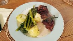 Steak with pepper sauce, boiled potatoes and asparagus