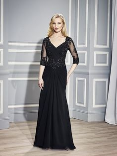 Val+Stefani+Style+MB7447 Lace+appliques+highlight+the+ruched+bodice+of+this+mermaid+silhouette+and+accent+the+sheer+3/4+sleeves.+A+high+keyhole+back+completes+this+look.+