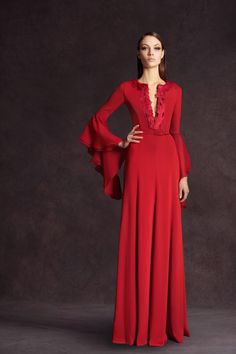 Red long dress with a deep split neckline and full smooth skirt. The slim sleeves have a to-die-for Medievel layered bell flounce. Andrew Gn Pre-Fall 2013. Photo: Anne Combaz / Courtesy Of Andrew GN