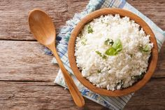 Cauliflower rice with basil in bowl close-up. Horizontal top view